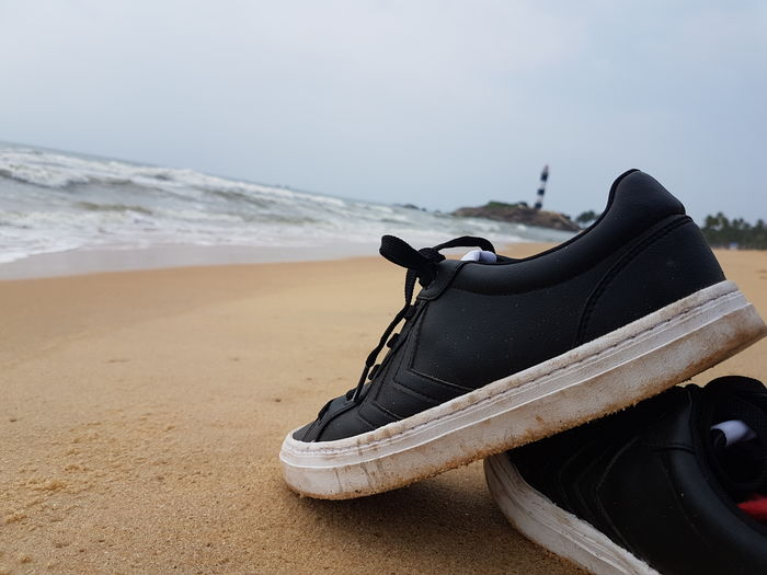 EyeEm Selects Beach Shoe Sea Sand Water No People Day Close-up Outdoors no edits. Lost In The Landscape Connected By Travel Perspectives On Nature The Great Outdoors - 2018 EyeEm Awards The Still Life Photographer - 2018 EyeEm Awards