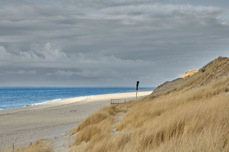 Sea Land Sky Water Beach Cloud - Sky Beauty In Nature Horizon Horizon Over Water Scenics - Nature Sand Tranquility Nature Grass Tranquil Scene Day Non-urban Scene Plant No People Outdoors Marram Grass Sylt Sylt, Germany Sylt_collection