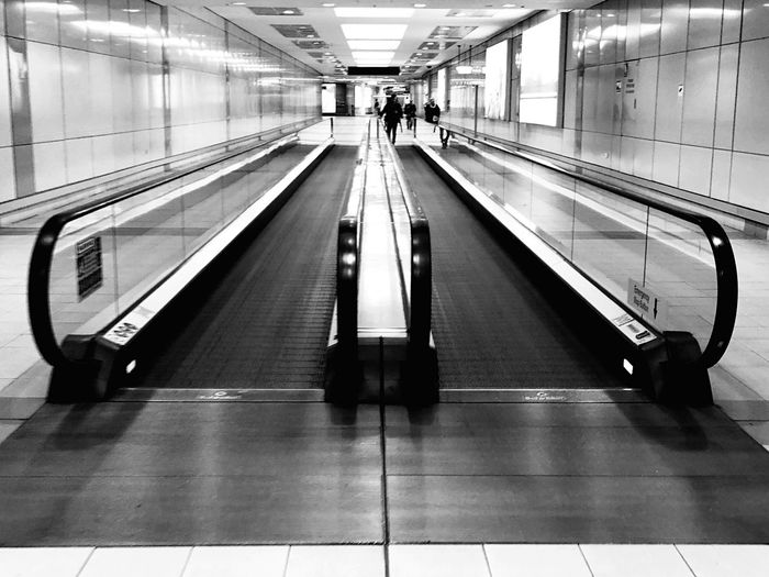 Architecture Convenience Transportation Indoors  Moving Walkway  The Way Forward Escalator Built Structure Railing Direction Airport Modern Technology Travel