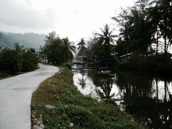 Malaysian island Tranquility Water Nature Scenics Day Village Boat Nautical Vessel Rainforest Island River Road