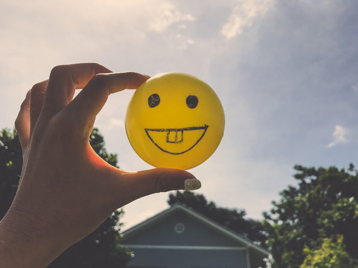 Smiley yellow ball with blue sky and nature background Fun Green Happy Joyful Love NOMAD Nature Retro Weekend Ball Blue Cheeze Close-up Day Film Filter Have A Nice Day♥ Joy Love ♥ Sky Smiley Smiley Ball Smiley Face Vintage Weekday Yellow