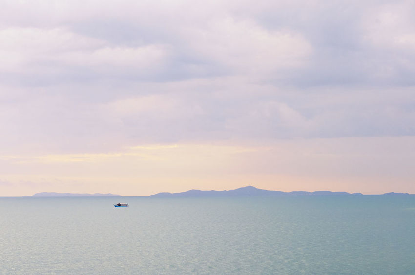 Beautiful scene from pattaya , Thailand. Atmospheric Mood Beauty In Nature Boat Cloud Cloud - Sky Cloudscape Day Distant Moody Sky Nature Non-urban Scene Ocean Outdoors Remote Scenics Sea Seascape Sky Tranquil Scene Tranquility Water Waterfront