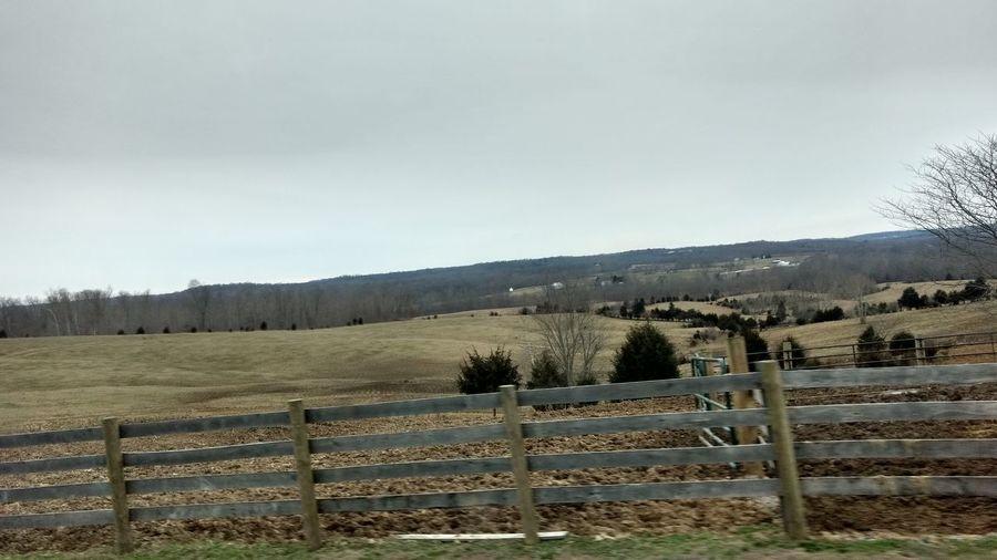 Fence in farm against sky