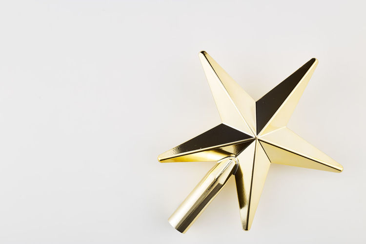 White Background Studio Shot Star Shape Indoors  No People Copy Space Single Object Close-up Still Life Paper Shiny Art And Craft Shape Cut Out Craft Gold Colored Christmas Creativity White Color Decoration Ornate