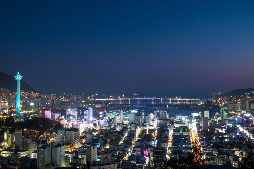 Night view of Busan, South Korea Busan,Korea Cityscape Light Trails South Korea Bridge Busan Light Trail Night View Night View Of City Sea Sea And Sky Tower