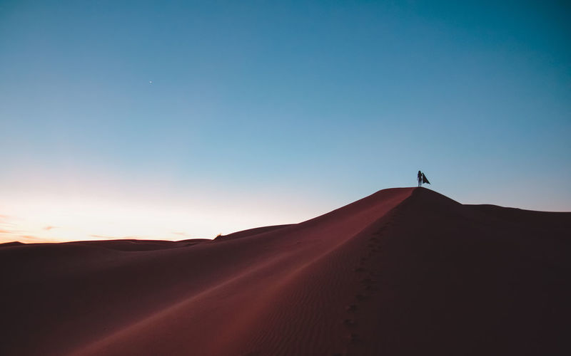 Dunes Lost In The Landscape Morocco One Person Only Sunset_collection African Beauty Beauty In Nature Clear Sky Desert Extreme Terrain Landscape Nature Non-urban Scene Outdoors Sahara Sand Sand Dune Scenics Silhouette Sunset Tranquil Scene Tranquility Travel Destinations