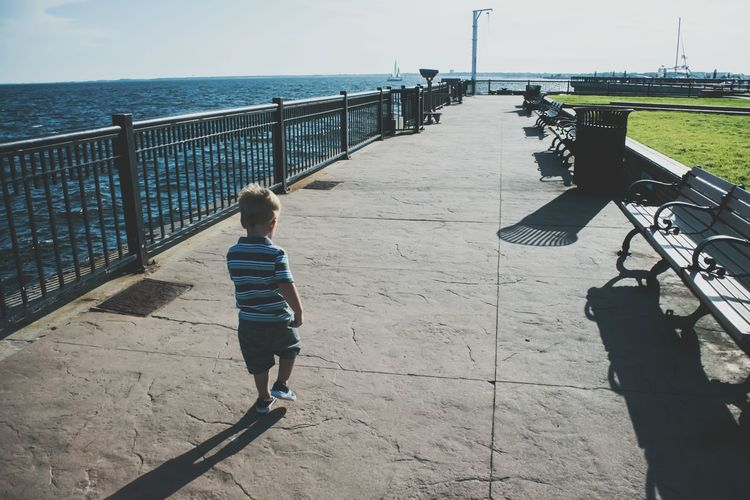 Leading The Way Boy Walking Independent  Childhood Long Walk Walking Pier Walkway Memory Lane Going Forward  Being Independent Being Adventurous Growing Up Ocean Walkway Lines The City Light Pensacola Florida Live For The Story Breathing Space EyeEm Ready