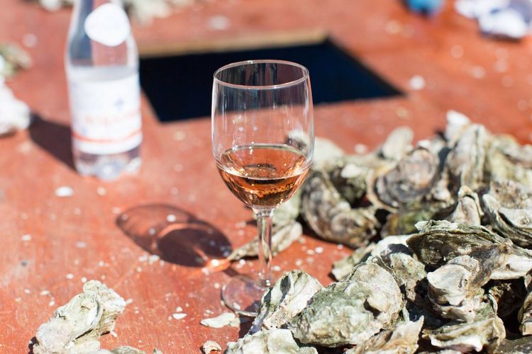 Oysters And Wine Oysters On The Half Shell Oyster Roast Oyster  Pink Color Pink Alcohol Wineglass Wine Drinking Glass Drink Food And Drink Food Stories Table Selective Focus Outdoors Freshness Refreshment Day No People Close-up
