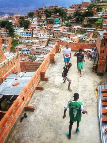 Men & their love for football. There's always time & a place for a kick around Look Down Comuna 13 Cultures Football EyeEmBestPics EyeEm Best Shots NOMAD Travel Medellín Cityscape Streetphotography Colombia Mid Adult Mid Adult Men Men Day Adult City Real People