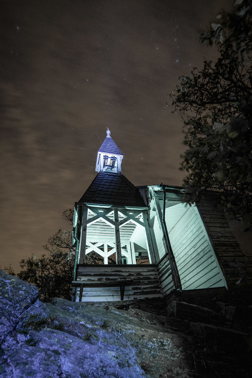 architecture, built structure, building exterior, building, no people, nature, tree, plant, night, religion, place of worship, tower, sky, outdoors, belief, spirituality, low angle view, water