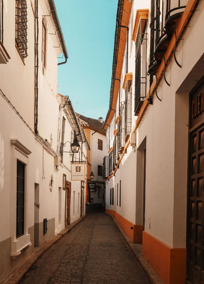 SPAIN Andalucía Old Town Orange Alley Narrow vanishing point Walkway Long Passageway The Way Forward Wall Lamp Cobblestone Diminishing Perspective Pathway Historic TOWNSCAPE Empty Road Townhouse