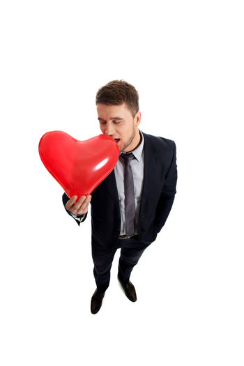 Valentine's Day  Balloon Business Businessman Corporate Business Full Length Heart Heart Shape Men Red Studio Photography Studio Shoot Studio Shot Suit Well-dressed White Background