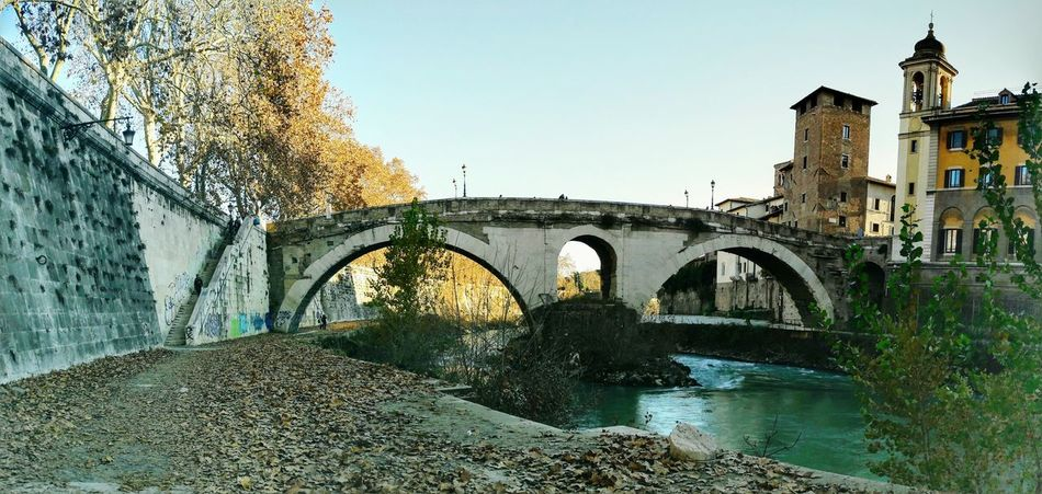 Ponte Fabricio, Fabricius Bridge or Ponte dei Quattro Capi, the oldest Roman bridge in Rome, Italy Bridge - Man Made Structure Arch Water Connection Architecture Cultures Tiber River Stone Rome, Italy Roman Oldest Bridge In Roma Island Heritage Culture European Travels Capital Of Italy