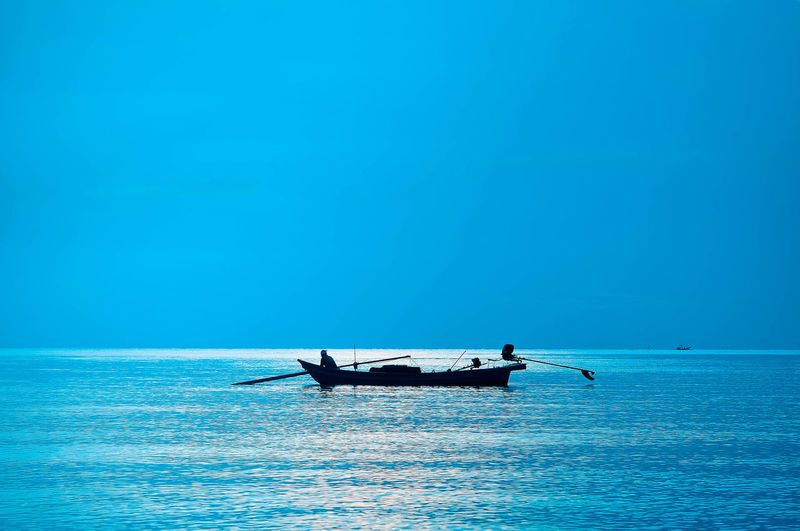 New Day Of Fishing Boat Samila Beach Songkhla Thailand Beauty In Nature Blue Clear Sky Copy Space Day Horizon Horizon Over Water Mode Of Transportation Nature Nautical Vessel Outdoors Scenics - Nature Sea Sky Tranquil Scene Tranquility Transportation Turquoise Colored Water Waterfront