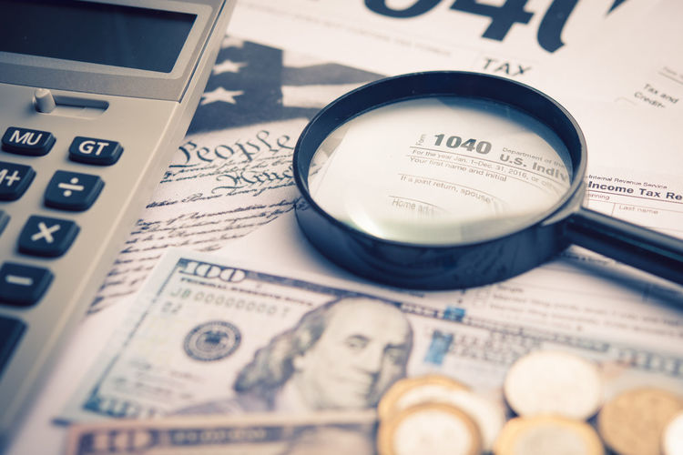 Finance Still Life Close-up Paper Text No People Selective Focus Business Currency Wealth Indoors  Communication High Angle View Full Frame Investment Western Script Document Education Magnifying Glass Newspaper Economy