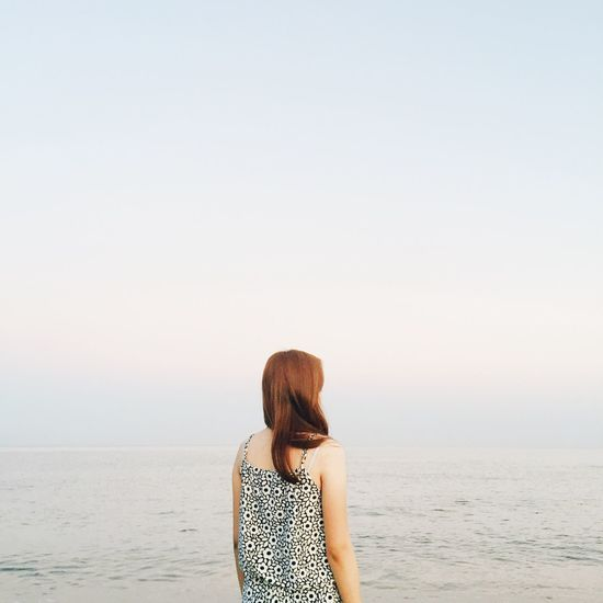 Rear view of a woman walking on beach