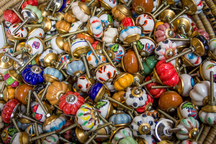 Full frame shot of colorful doorknobs