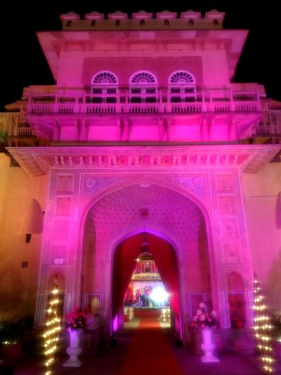 Night Architecture Built Structure Illuminated Arch Building Exterior Pink Color City No People Outdoors Triumphal Arch Sky Royal Wedding Indian Wedding The Palace Of The King Bestseller2017 Nightphotography Night Lights Nightlife EyeEmNewHere Beautiful Ancient Architecture Ancient Celebration Event Tradition Millennial Pink Neon Life