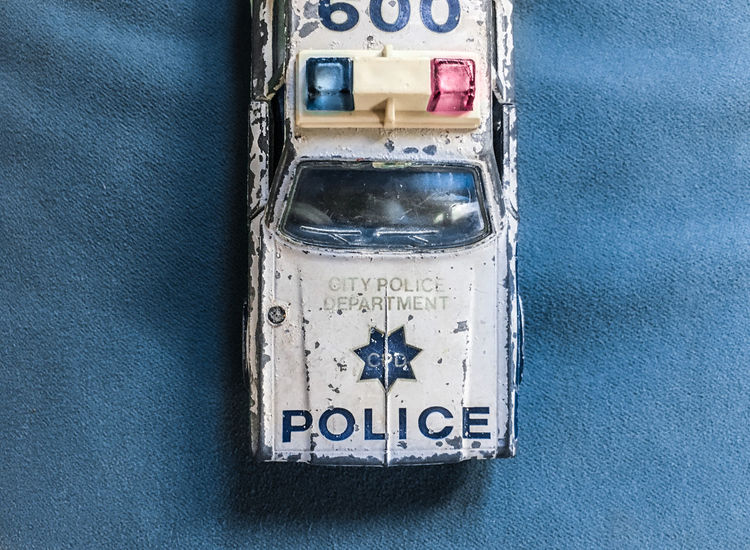 The old Car I Blue Damaged Dirty Emergency Light Full Frame Geometric Shape Glass - Material Metal No People Old Car Police Scratches Toy Car Toy Car Close Up The Still Life Photographer - 2018 EyeEm Awards