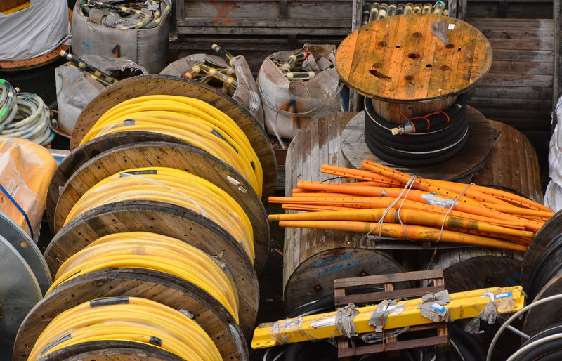 Industrial Cable Reals Close-up Day Food For Sale Large Group Of Objects No People Orange Colours Outdoors Shipping Cable Yellow Industrial Cable Heavy Gauge Hosepipe Reels Premium Collection Postcode Postcards End Plastic Pollution The Still Life Photographer - 2018 EyeEm Awards