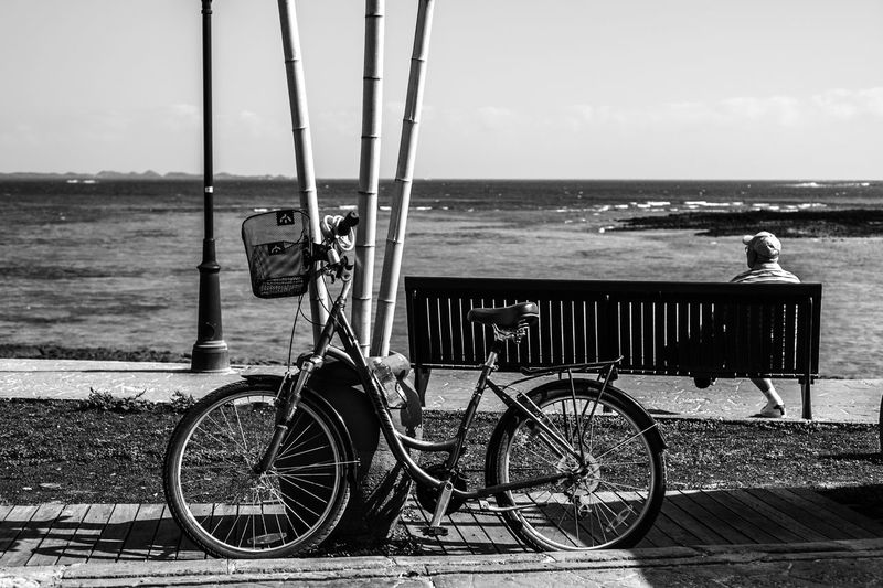 Bicycle Parked Against Sea