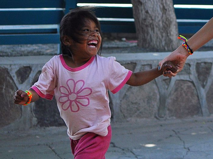 Cielo // The smile she wears on this day is because she does not have to go to work with her parents in the fields of Baja California. She was dropped off at the local orphanage for daycare where there are volunteers who will play with her and provide activities that allow her to just be a kid. Cielo suffered from health issues related to the pesticides that are used on the crops. Fortunately her parents have found a safe place for her to go while they work. Many children are not so lucky and the exposure at such a young age can lead to many health problems down the road. There is a high cost to inexpensive imported fruit and vegetables and the health of the migrant workers children is one of them. Nikon Innocence Border Stories Beyond The Border Project Esperanza Mexico Photojournalism Poverty Beautiful Girl Beautiful Child Portrait Children Happiness Child Poverty The Photojournalist - 2016 EyeEm Awards Capture The Moment The Portraitist - 2016 EyeEm Awards Telling Stories Differently Documentary Photography