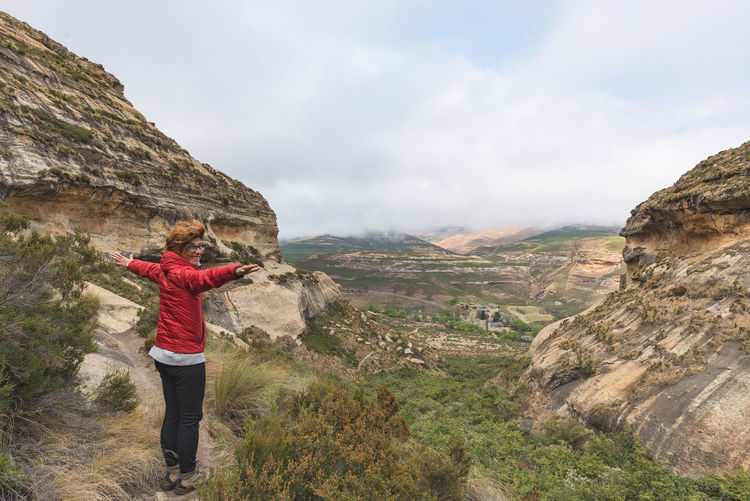 Female hiker standing on mountain at golden gate highlands national park