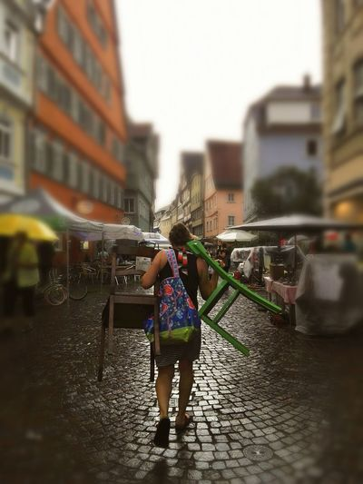 EyeEmNewHere Architecture Built Structure Building Exterior Real People Full Length Wet Walking Outdoors One Person Lifestyles City Women People Strong Woman Germany Flohmarkt