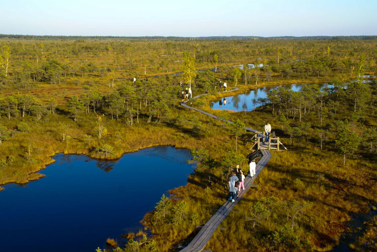 High angle view of people walking by lakes on landscape