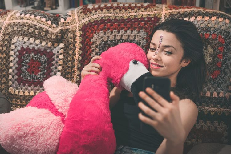 Mr. F has a girlfriend. Selfie ✌ Sitting On Couch Flamingo Pink Flamingo Toy Toy Stuffed Toy Taking Photos Taking A Selfie Adult Only Women Adults Only One Woman Only Women One Person Smiling People Holding Portrait Human Body Part Happiness Cheerful Lifestyles Young Adult Relaxation Human Face