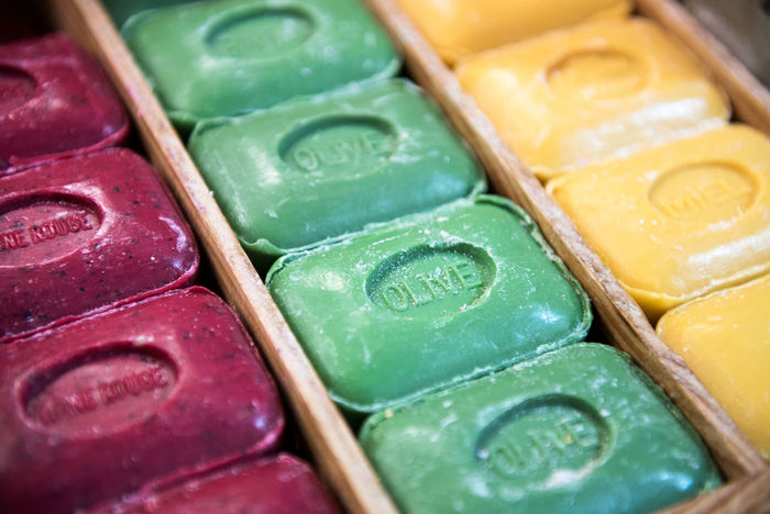Rows of colorful traditional French hard Marseille soap in close-up view Hygiene Marseilles Natural AssoRted Bars Display French Handmade Multi Colored Soap Traditional
