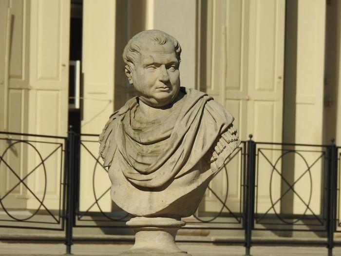 Portrait of statue against railing