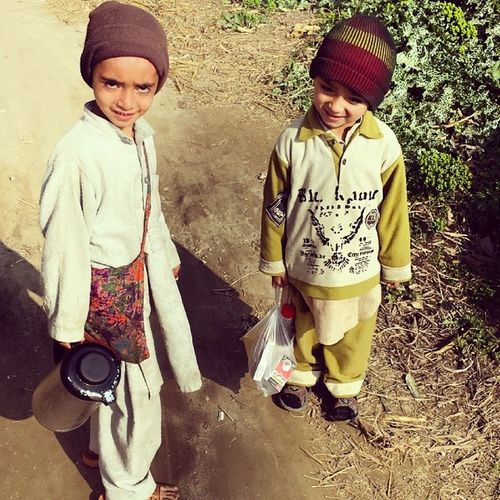 2 kids taking tea n edibles for their elders working in the fields. Pakistan Pakistanifood Swabi Dodher instafood instaphoto instapic picoftheday tea coffee brunch lunch teatime