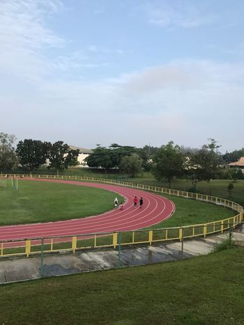 Sport Tree Sky Sports Track Grass Playing Field Day Field Running Track No People Cloud - Sky Competition Stadium Soccer Outdoors Sports Venue Soccer Field Sports Race Competitive Sport Nature