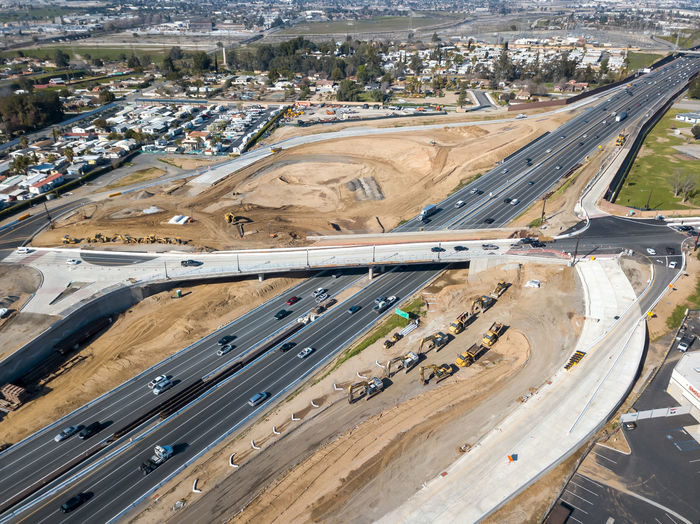 Grand Terrace, CA / USA - 2/24/2019: Aerial view of the Barton Road / 215 Interchange Under Construction Freeway Transportation Overhead View Roundabout Overpass Interchange  High Angle View Road Day No People Built Structure Industry Aerial View Connection Multiple Lane Highway Highway City Architecture Infrastructure Construction