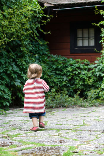 At Julita Gård in summer 2016. Childhood Full Length Child One Person Plant Rear View Real People Standing Day Casual Clothing Walking Lifestyles Leisure Activity Nature Architecture Outdoors Innocence Females Green Color Girl Girls Discovering Exploring Julita Julita Gård Lush Cottage