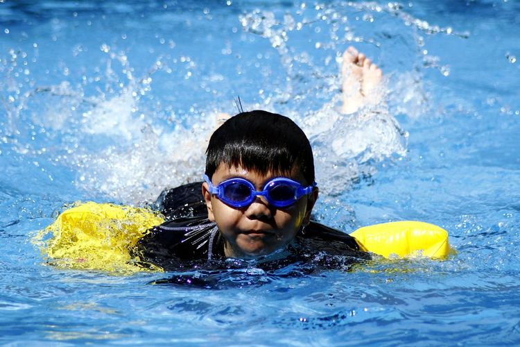 Portrait Of Boy Swimming In Water