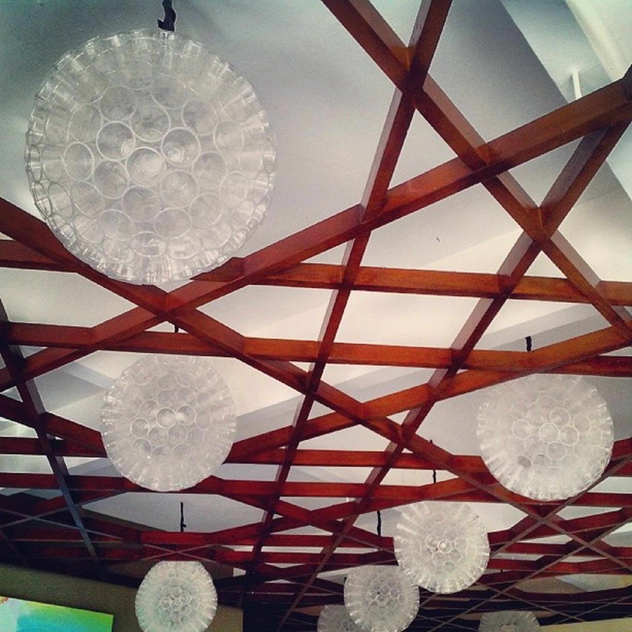 art and craft, indoors, circle, art, pattern, creativity, design, low angle view, decoration, ceiling, sphere, geometric shape, ornate, shape, built structure, sky, hanging, close-up, amusement park, religion