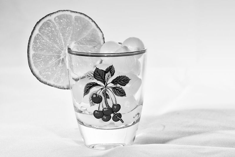 Cocktail onions with a slice of lime in a shot glass. Black and white low key photo. Cherries Cocktail Cocktail Time Lime Slices Low Key Black And White Black And White Collection  Black And White Photography Cheers Cocktail Onions Drinking Glass Food And Drink Lime Low Key Lighting Low Key Photography No Alcohol Onion Onions Shot Glass Slice Of Lime Studio Shot