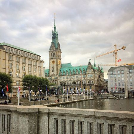 Architecture Building Exterior Built Structure City City Life Clock Tower Cloud - Sky Crane - Construction Machinery Day Development Famous Place Germany Hamburg Old Town Outdoors Parliament Building Sky Spire  Storm Cloud Tall - High Tourism Tower Travel Travel Destinations Water