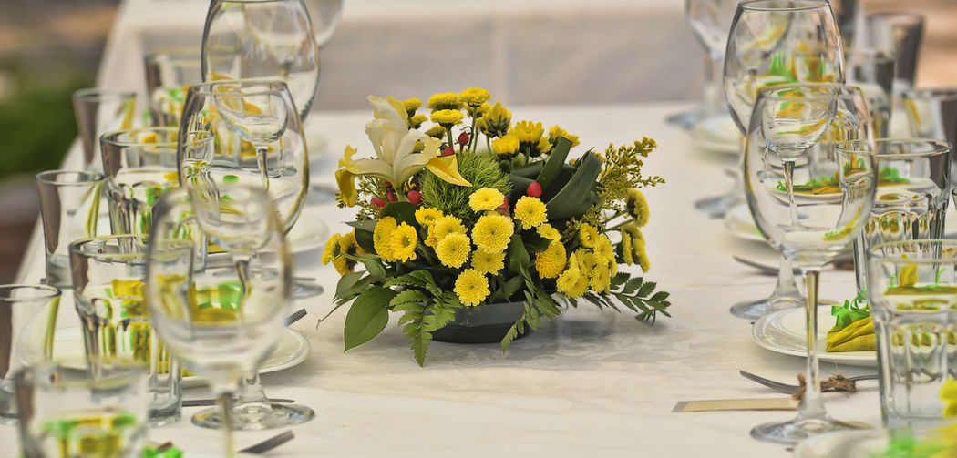 Flowers in glass vase on table