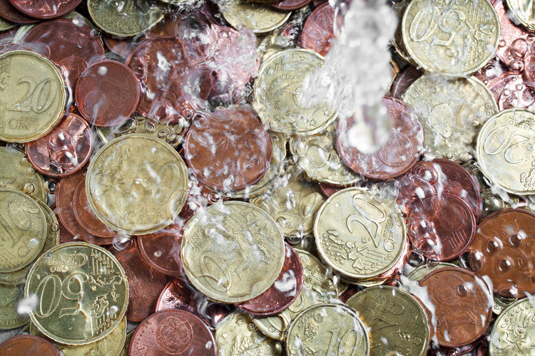 money laundering concept , coins under tap water , black money Money Laundering Money Laundry Money Money Money Money Coin Coins Economy Crisis Finance Currency Currency Symbol Full Frame No People Abundance Backgrounds Close-up Metal Silver Colored