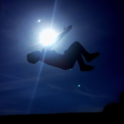Silhouette Sun One Person Leisure Activity Low Angle View Sunlight Sky Outdoors Backflip Sommergefühle