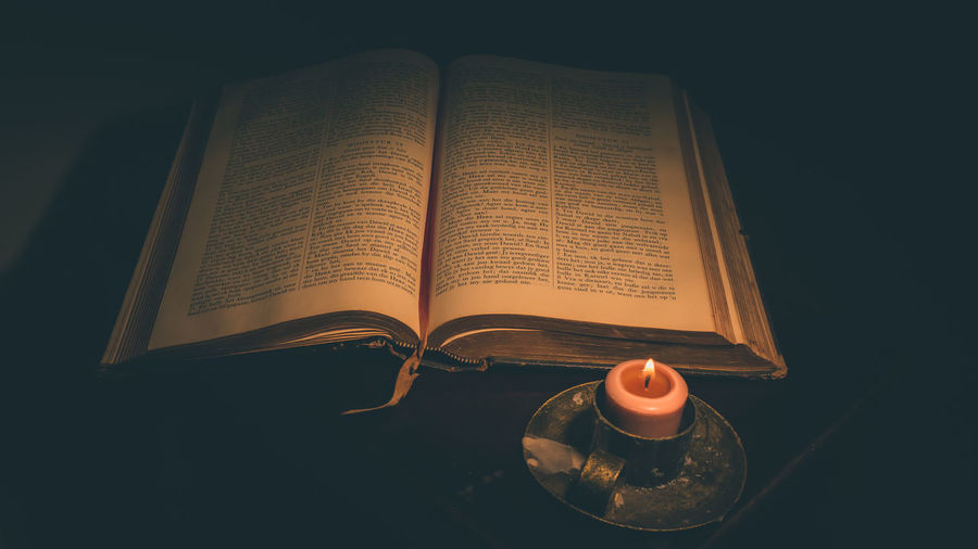 Beliefs Bible Book Byble Candle Candlelight Close-up Education High Angle View Indoors  No People Old Open Page Relegion Religion Spirituality Spirituality Table Vintage Wisdom