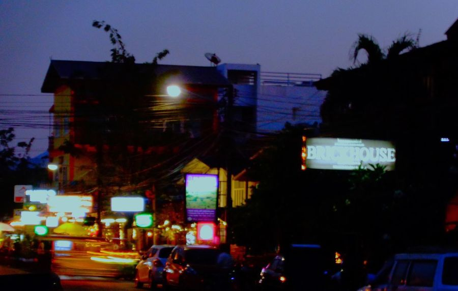 Street Backpackers Brickhouse Night Illuminated Dusk Transportation Mode Of Transport Land Vehicle Built Structure Architecture Sky Outdoors Silhouette City Building Exterior