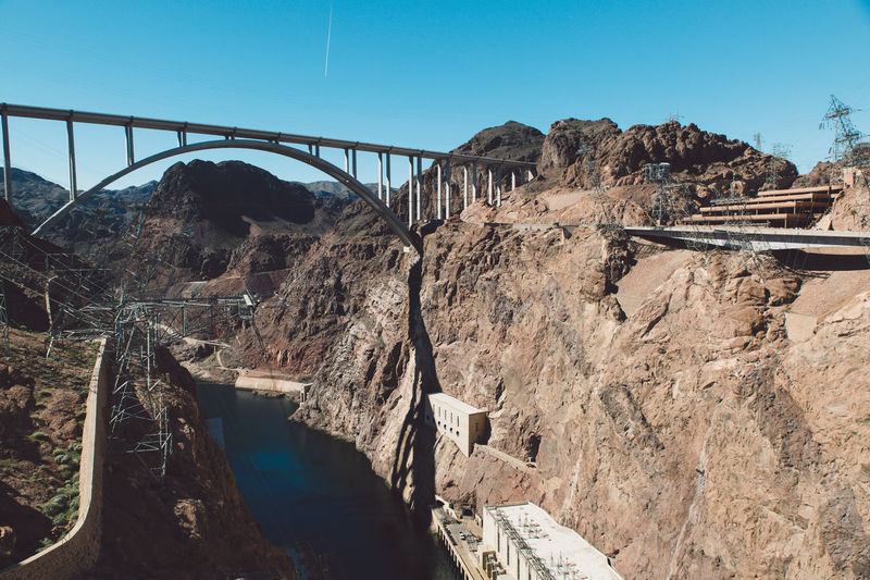 Arch Architecture Arizona Bridge Bridge - Man Made Structure Building Clear Sky Colorado River Concrete Connection Construction Dam Day Electricity  Hoover Dam Hydroelectric Power Lake Mountain Nature Nevada No People Outdoors Reservoir River Rock - Object Gridlove