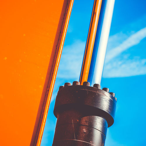 Minimalism - Hydraulic engine Sky Metal No People Low Angle View Day Close-up Blue Industry Nature Cloud - Sky Outdoors Architecture Orange Color Focus On Foreground Built Structure Sunlight Factory Building Exterior Red Pole Silver Colored Alloy