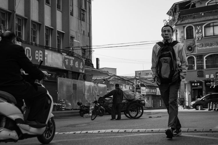 Human Traffic ~ The Street Photographer - 2018 EyeEm Awards Architecture Building Exterior Built Structure Casual Clothing City City Life Crash Helmet Day Full Length Group Of People Land Vehicle Leisure Activity Lifestyles Men Mode Of Transportation Monochrome Motorcycle Outdoors People Real People Riding Sky Street Transportation