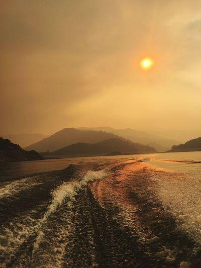 Wildfire Smokey Forest Sun Smoke Mountain Boating Wake Water Wake Lake Water Sky Sea Scenics - Nature Sunset Beauty In Nature Tranquil Scene First Eyeem Photo