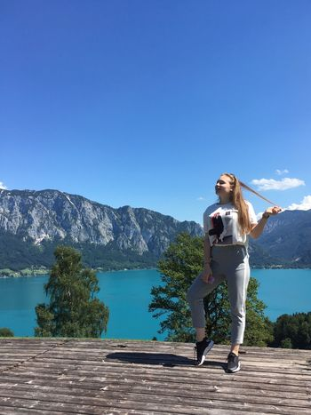 Mountain Blue One Person Clear Sky Copy Space Water Day Nature Beauty In Nature Outdoors Lake Standing Young Women Sunlight Full Length